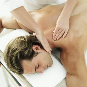 Young Man Getting a Massage --- Image by © Royalty-Free/Corbis